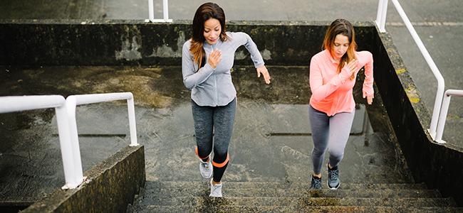2 women running up stairs