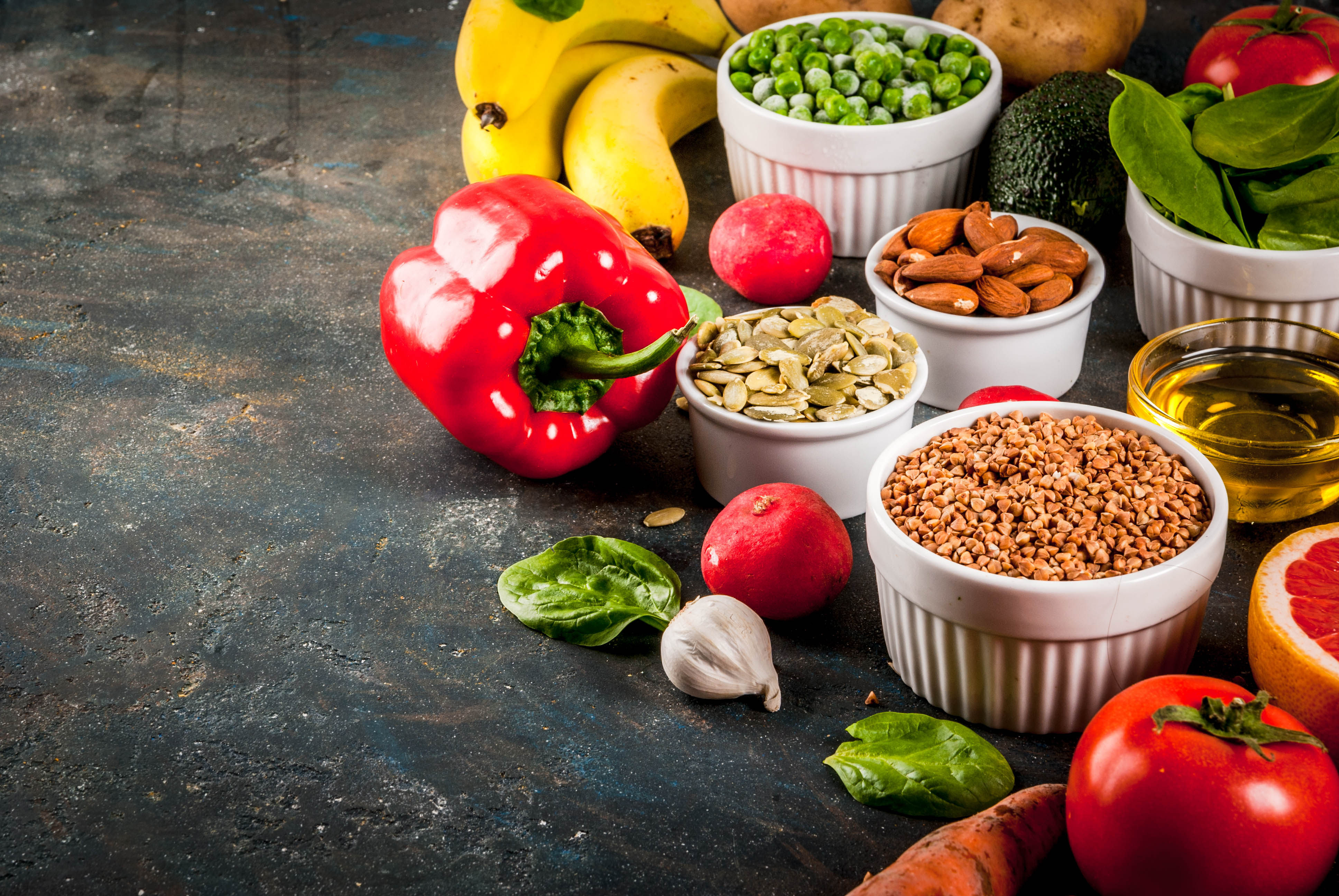 Various Fruit, Vegetables, and Nuts on a table