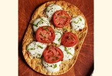 Tomato basil thin-crust low carb pizza